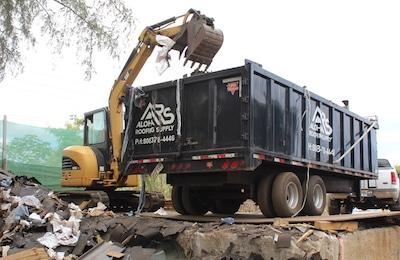 Roof debris hauling and disposal